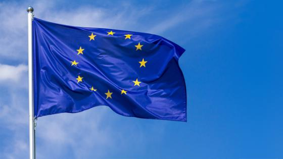 An EU flag with the sky as background