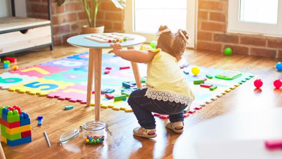 toddler in a children's room with toys