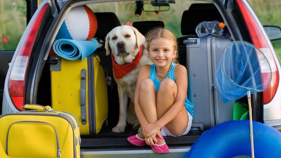 Girl with a dog in the trunk